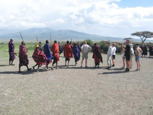 masai showing their dance moves to tourists